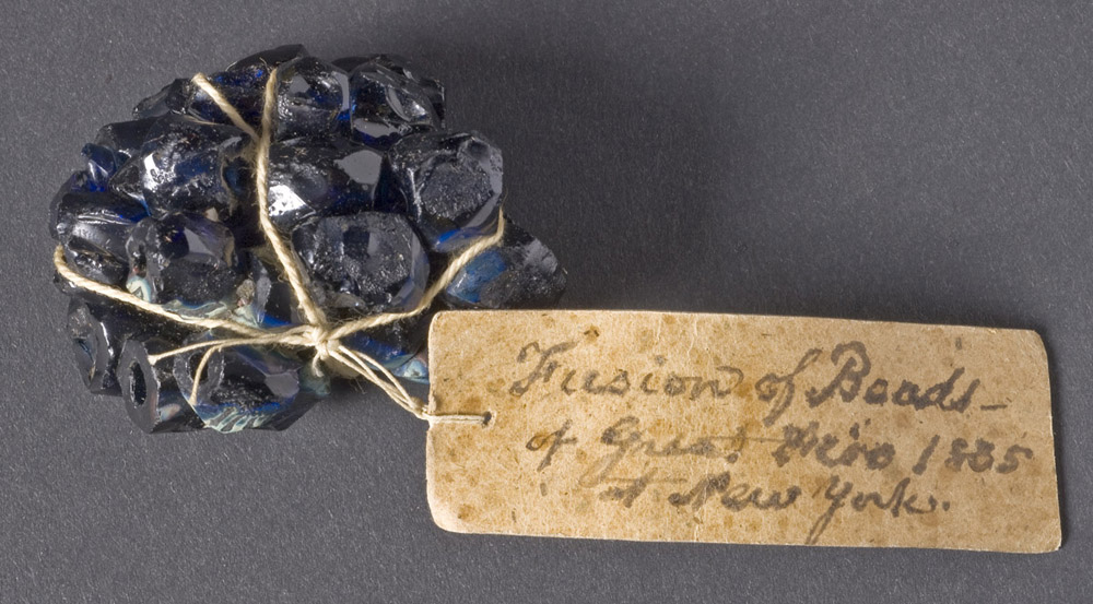 Glass beads fused together in the 1835 Great Fire of New York City, Museum Collection 1958.102.11.