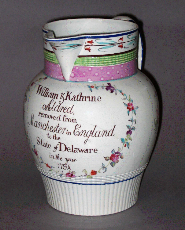English earthenware jug with pearlware glaze. To achieve its decoration, the potter fired the jug multiple times. The first was a biscuit firing to harden the clay and the second was a gloss firing to adhere the glaze. Once twice-fired, the white body of the jug was perfect for receiving colorful hand-painted enamel decorations that necessitated subsequent re-firings. Winterthur Museum 1992.0069.