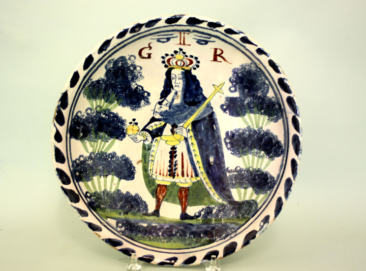 Charger, early 18th-century, England. Depicts King George II wearing his robes and carrying his orb and scepter.