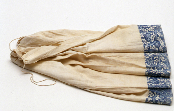 This petticoat suggests what Ann Dawson's petticoat, with a printed-fabric border, looked like. Dawson was a runaway servant in Chester County, Pennsylvania, in 1765. This petticoat, made of plain-woven linen, has a five-inch border of fabric printed in blue with a resist method.  Museum purchase with funds provided in part by Mrs. Vietor, Mrs. Ruth Lord, and Mrs. Porter Schutt 1995.0028