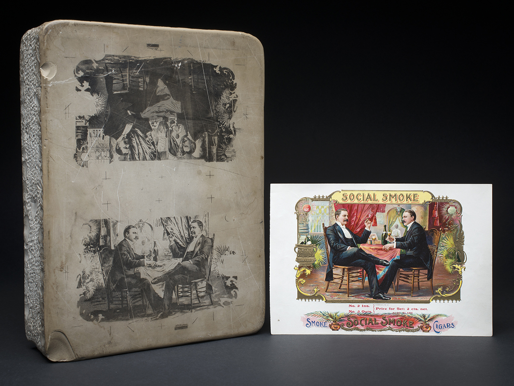 "This 35-pound lithographic stone was part of a five-stone set, each with two images, that produced the ten- color ""Social Smoke"" cigar label.  Note the mirror image on the label."