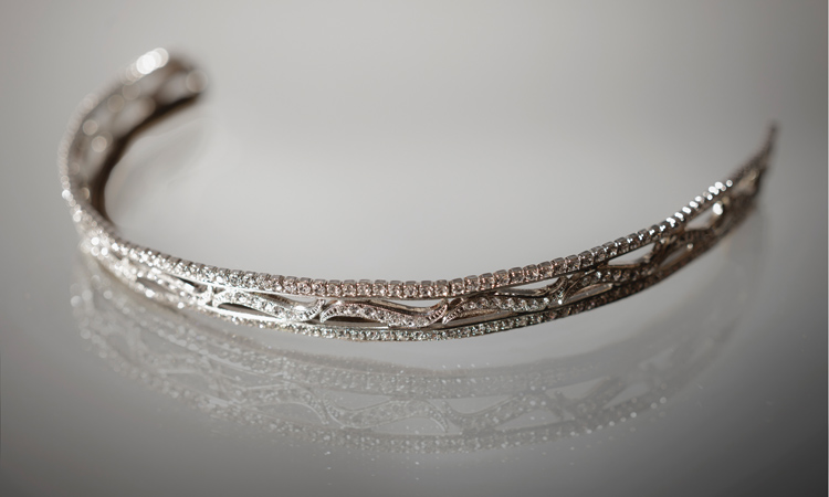This stunning wave scroll tiara of Swarovski crystals was worn by Lady Mary Crawley in Season Three of the show.