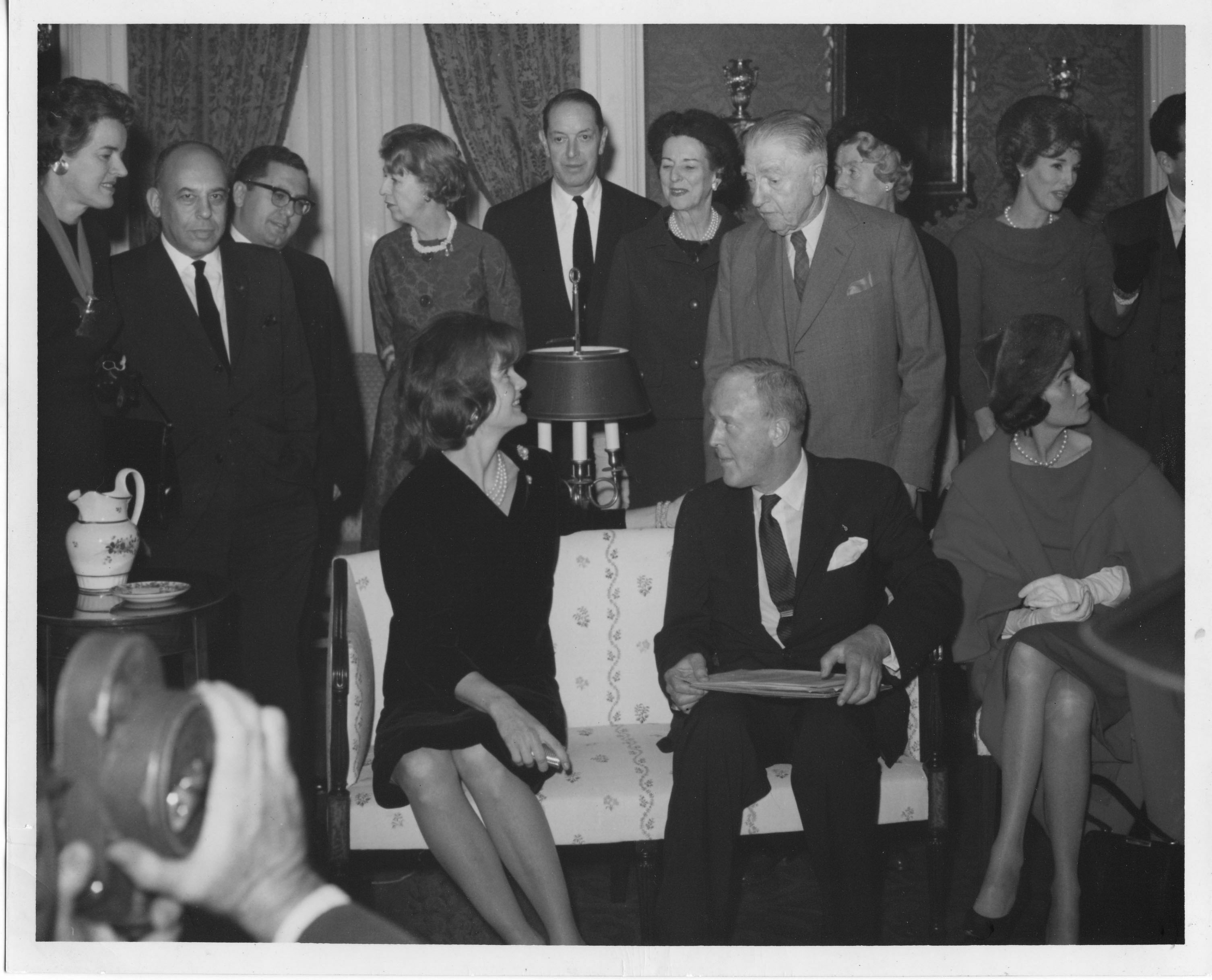 Jacqueline Kennedy (seated, left) and H. F. du Pont (standing fourth from right), along with members of the Paintings Committee of the Fine Arts Committee, December 1961.