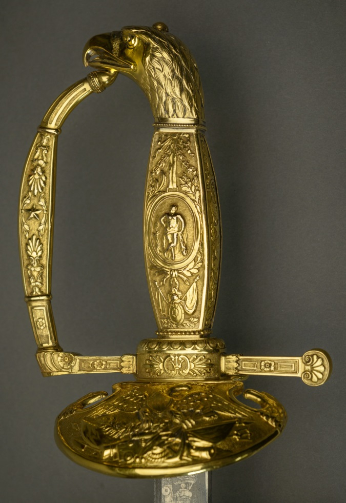 The bald eagle pommel depicts Neptune and his trident.