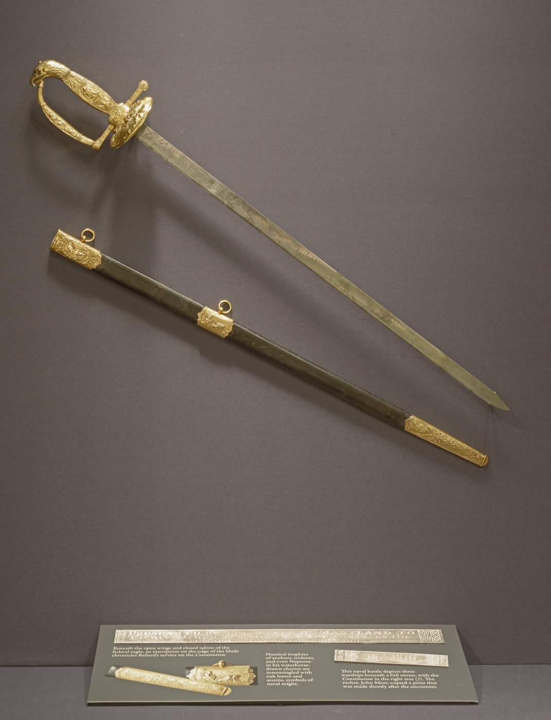 Sword and scabbard, Presented to Lieutenant Henry E. Ballard by the State of Maryland. Designed and made by Thomas Fletcher & Sidney Gardiner; blade makers: William Rose, Sr., and John Meer, Sr., Philadelphia, Pa.,1829. Gold, steel, wool, leather. Museum purchase with funds provided by the Henry Francis du Pont Collectors Circle 2015.4.1