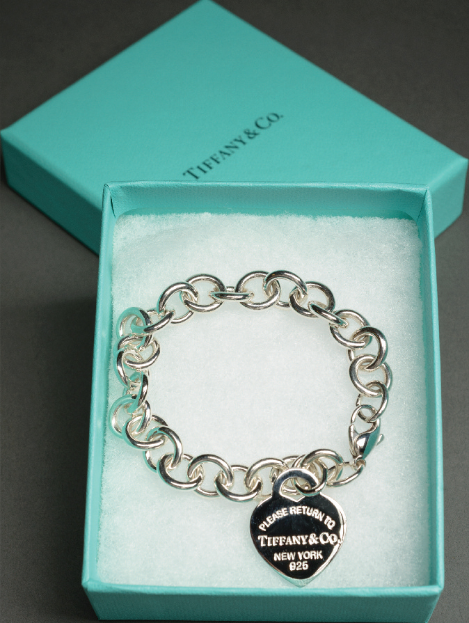 Tiffany & Co. charm bracelet and recognizable blue box.