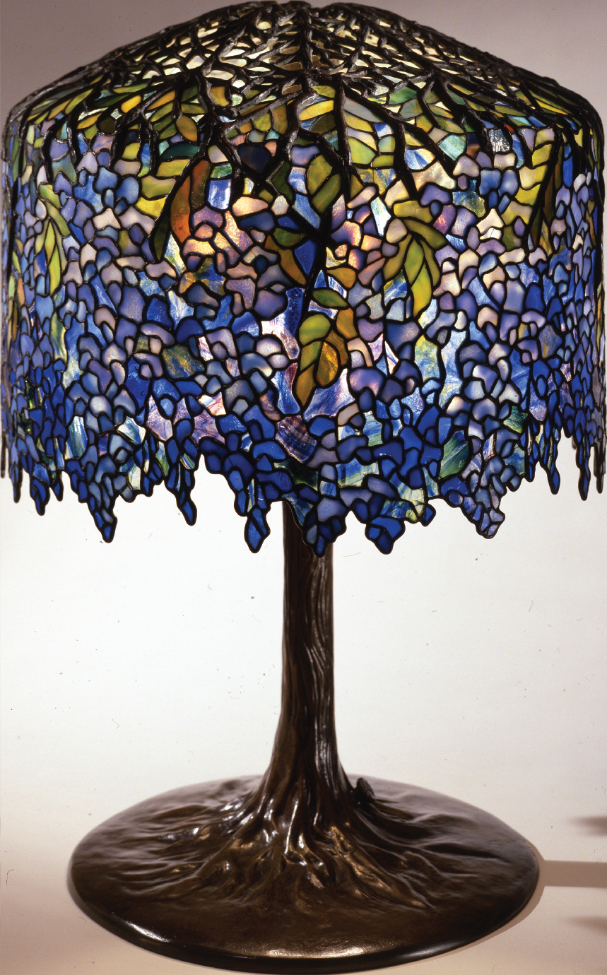 Wisteria library lamp, Tiffany Studios (designed by Clara Driscoll), ca. 1901. Leaded glass, bronze. 26½ x 18 in. The Neustadt Collection of Tiffany Glass, Queens, N.Y.