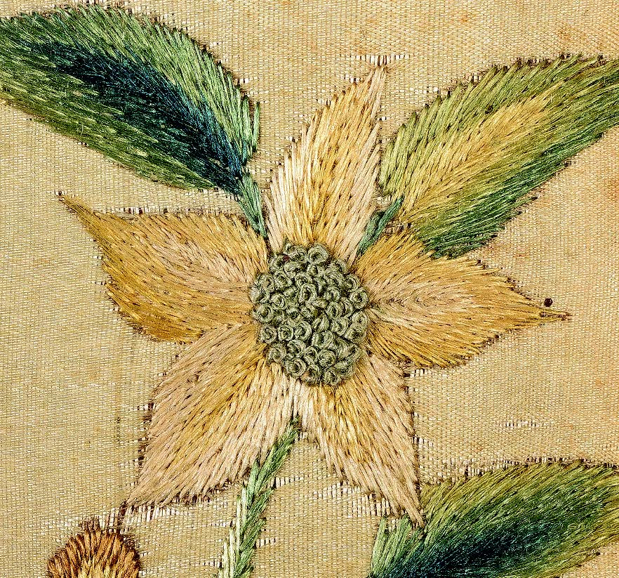 Detail of needlework picture by Ann Carlisle