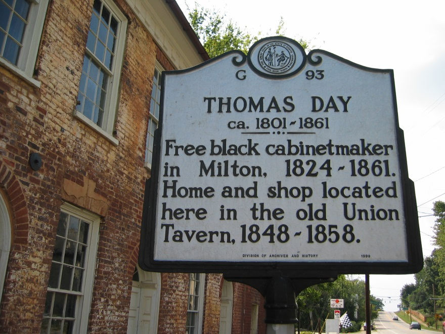 Thomas Day Historic Marker in front of the Union Tavern in Milton, North Carolina, Thomas Day's home and workshop. Erected in 1999 by the Division of Archives and History (Marker Number G-93). This particular image taken from http://www.rootsweb.ancestry.com/~ncccha/biographies/thomasday.html